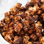 close up hot of caramel chocolate vegan popcorn in a bowl
