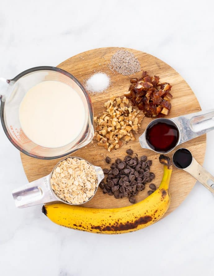 Ingredients for Chunky Monkey Overnight Oats laid out on a board