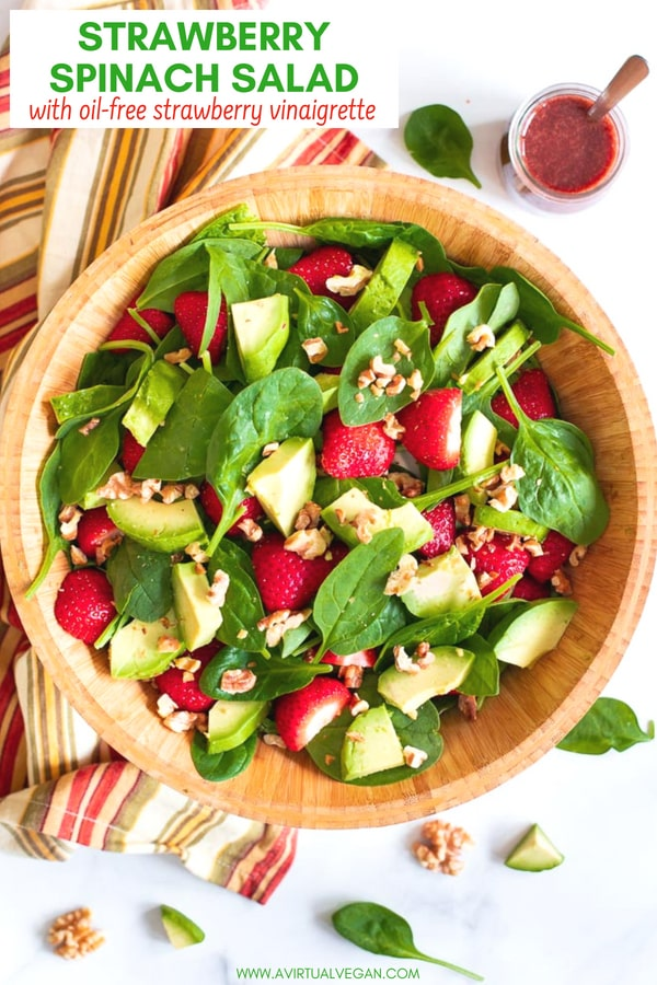 A simple, super tasty Strawberry Spinach Salad made with iron rich spinach, juicy strawberries, creamy avocado & crunchy nuts, then finished off with a fresh, oil-free, strawberry vinaigrette. #salad #strawberry #strawberries #avocado #spinach #oilfree #vegan #avocado