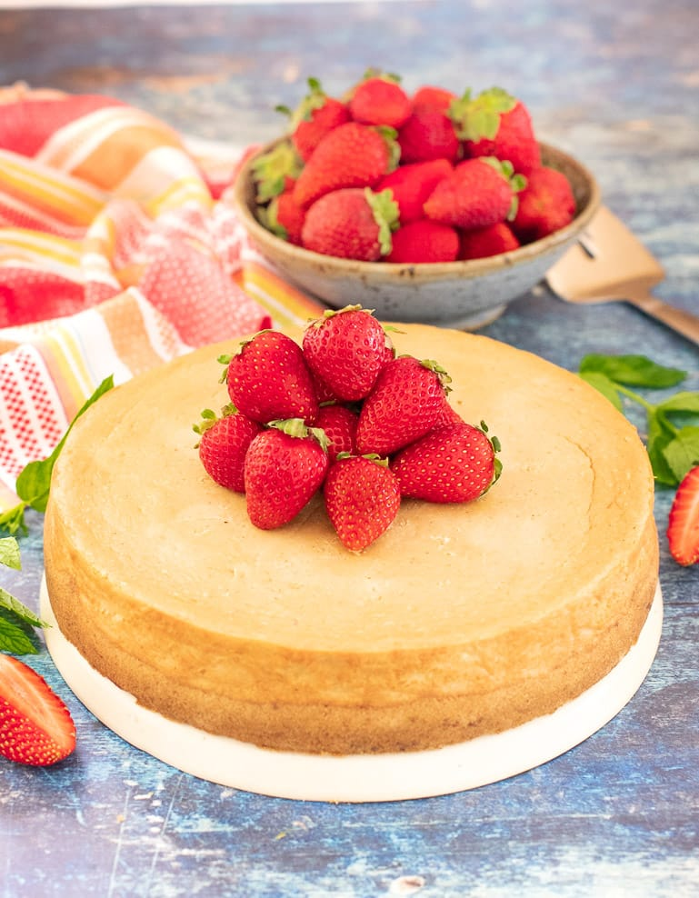 Vegan New York Cheesecake topped with fresh strawberries