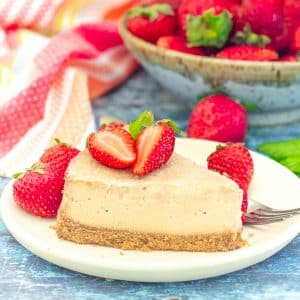 a slice of vegan cheesecake with strawberries on a plate