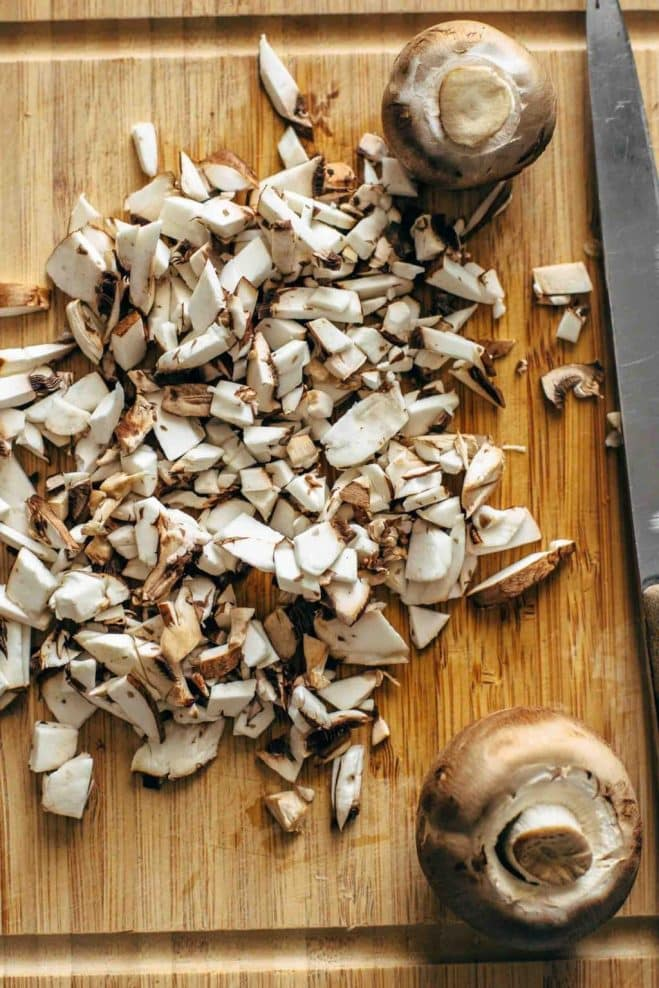 chopped mushrooms on a board