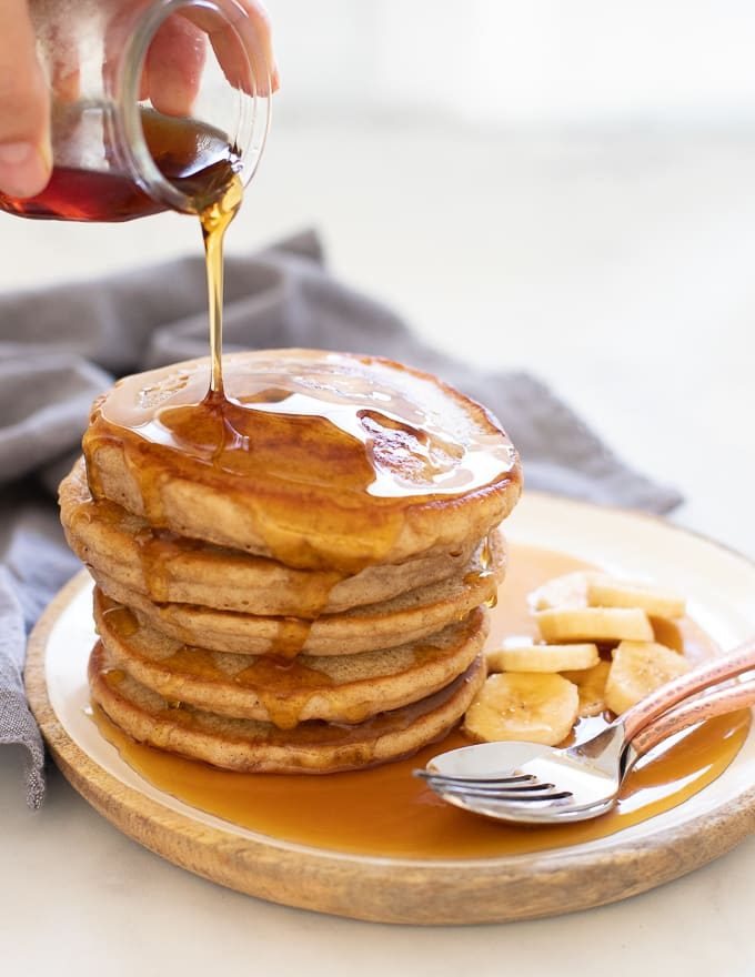 Vegan Banana Pancakes drizzled with maple syrup
