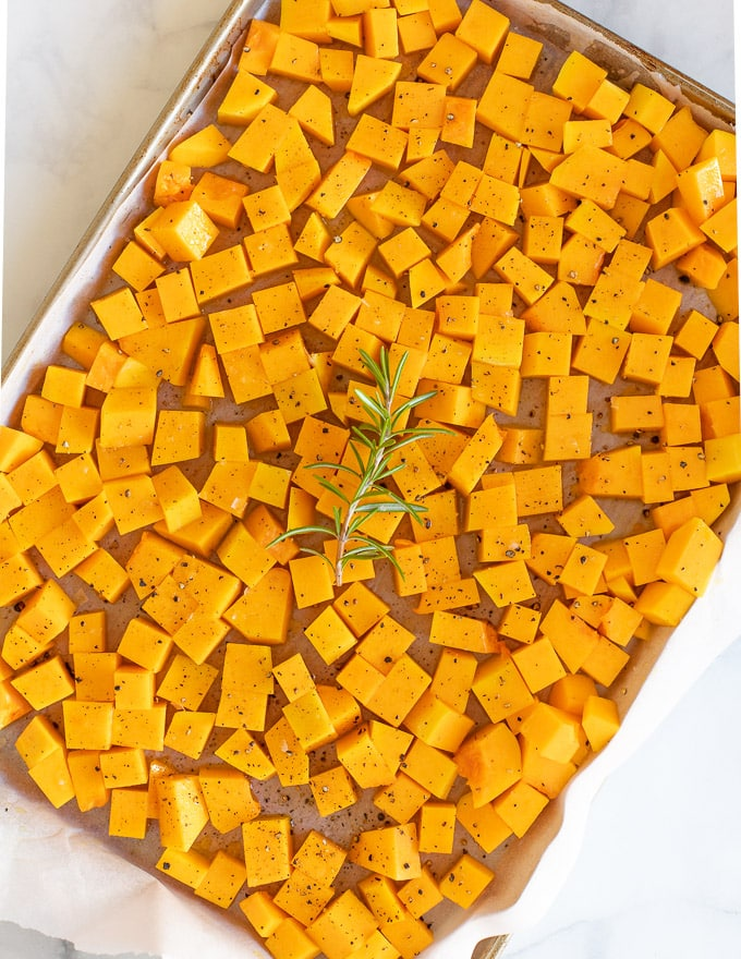 chopped butternut squash on a baking tray