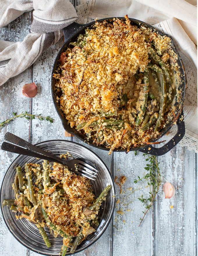 A made-from-scratch Vegan Green Bean Casserole with tender green beans baked up in a deliciously creamy mushroom sauce, and topped with crispy, golden, buttery breadcrumbs and tangles of caramelized onions. This really is the ultimate way to eat green beans!
