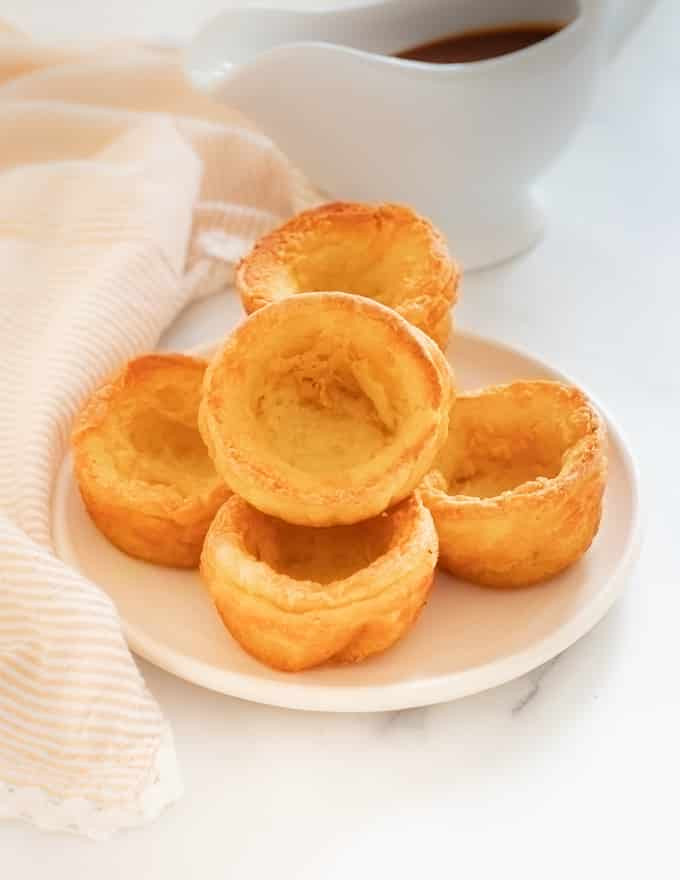 Vegan Yorkshire Puddings piled on a plate