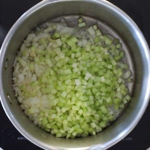 celery and onion sautéing in a pan - ready to make vegan potato soup