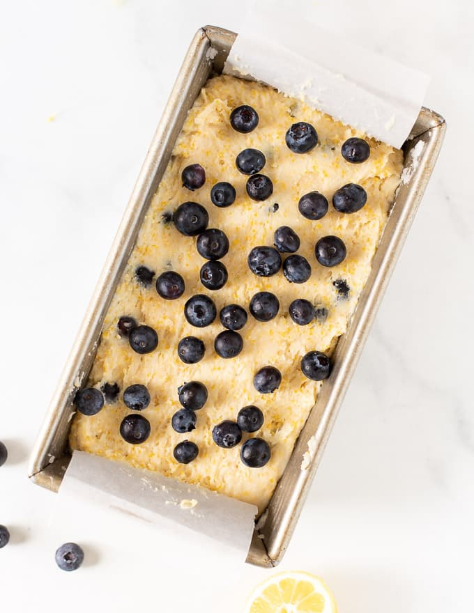 uncooked lemon blueberry loaf in loaf pan