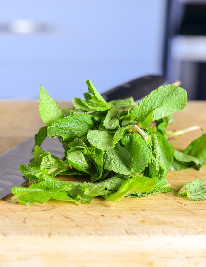 mint on a board ready to be chopped for a Watermelon Mint Salad