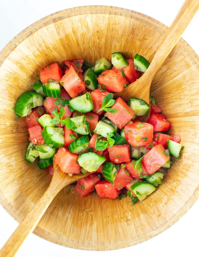 Watermelon Mint Salad in a wooden salad bowl, shot from above