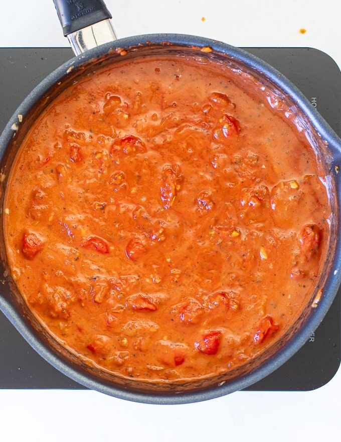 Cherry Tomato Sauce simmering in a pan