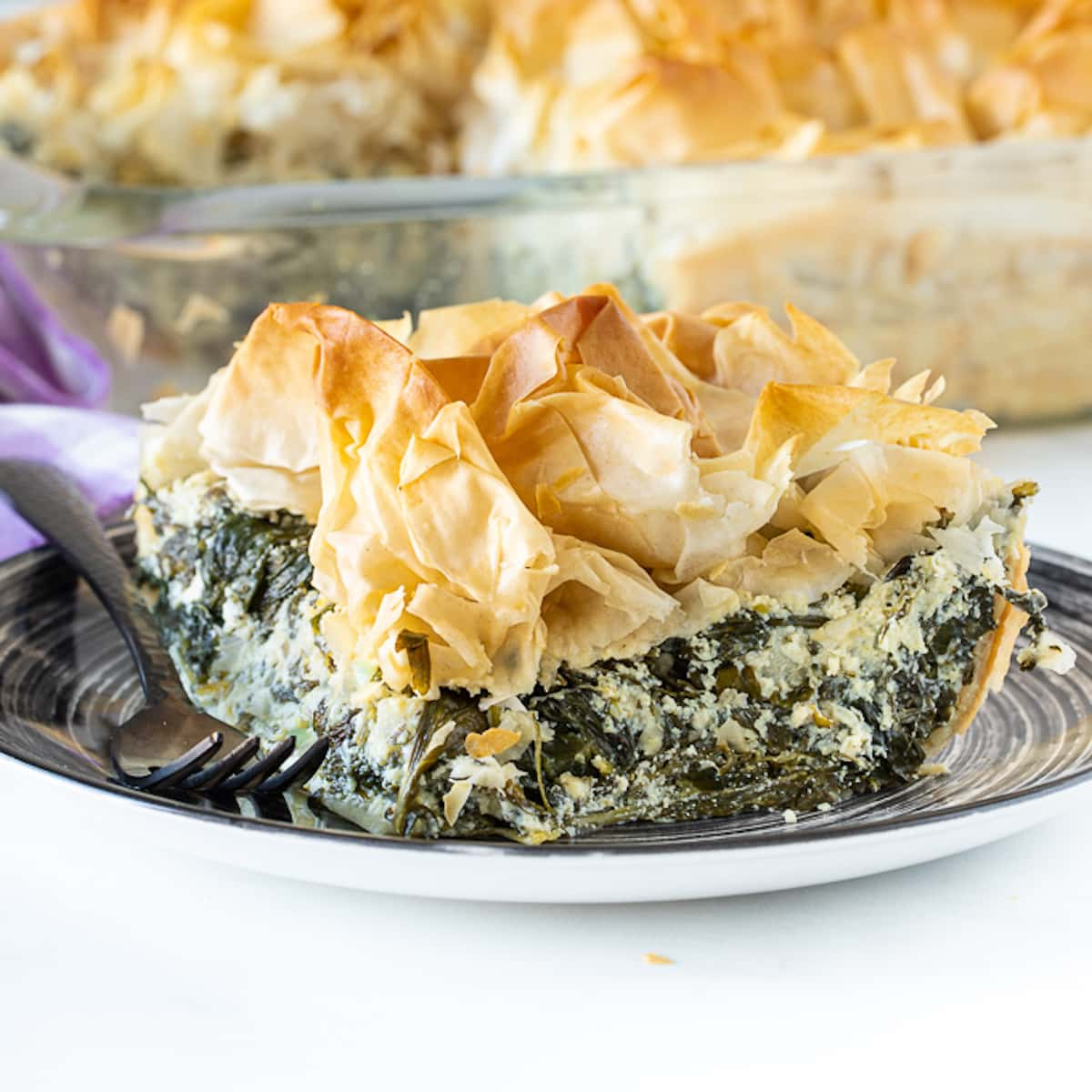 a slice of vegan spanakopita