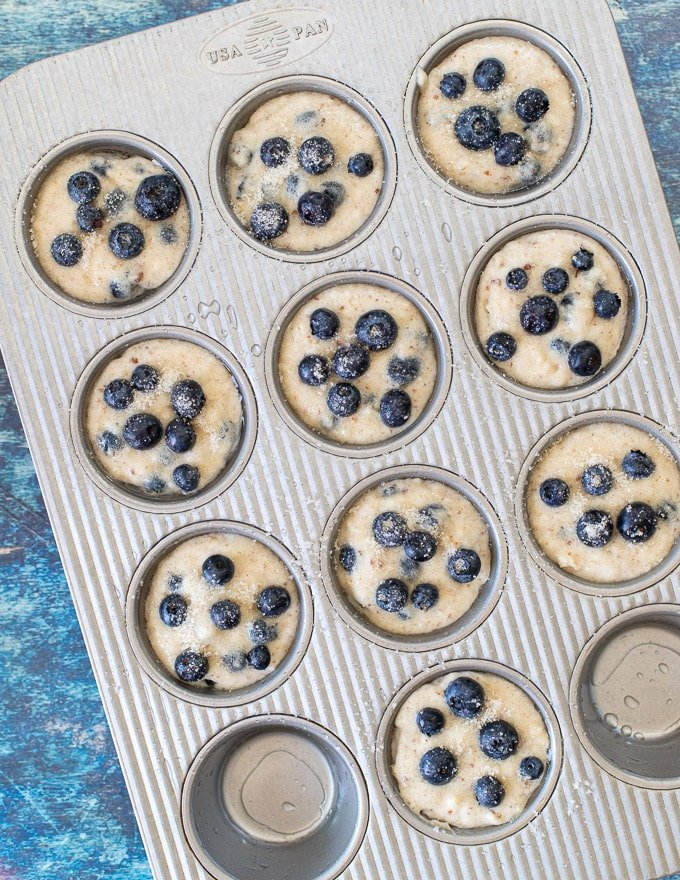 uncooked vegan blueberry muffins in a pan