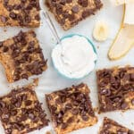 healthy breakfast bars with a bowl of vegan yogurt and sliced banana