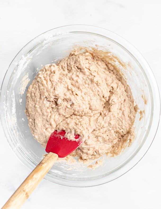 vegan apple cake batter in a mixing bowl