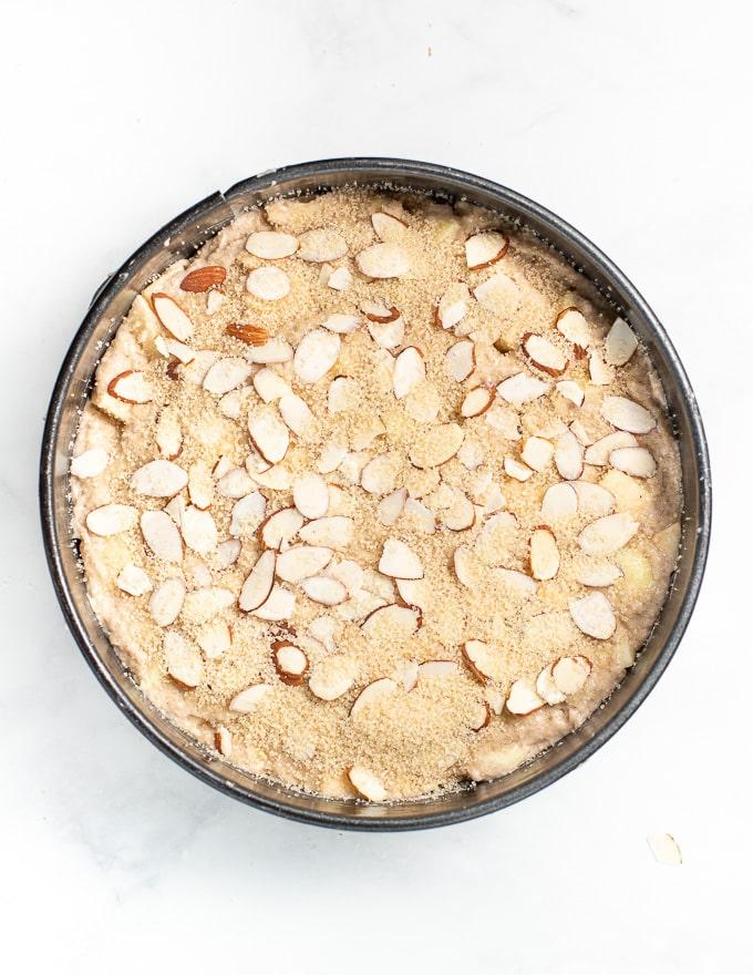 vegan apple cake in a pan prior to baking