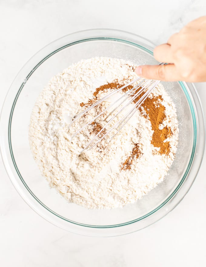 dry ingredients for vegan apple cake being mixed up in a bowl