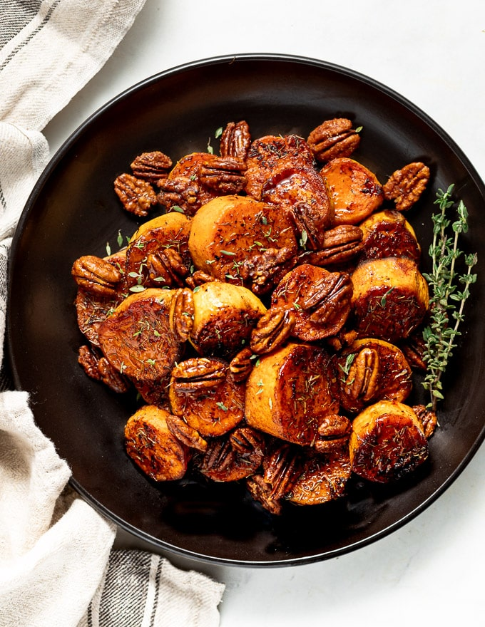 a plate of Melting Cinnamon Roasted Sweet Potatoes