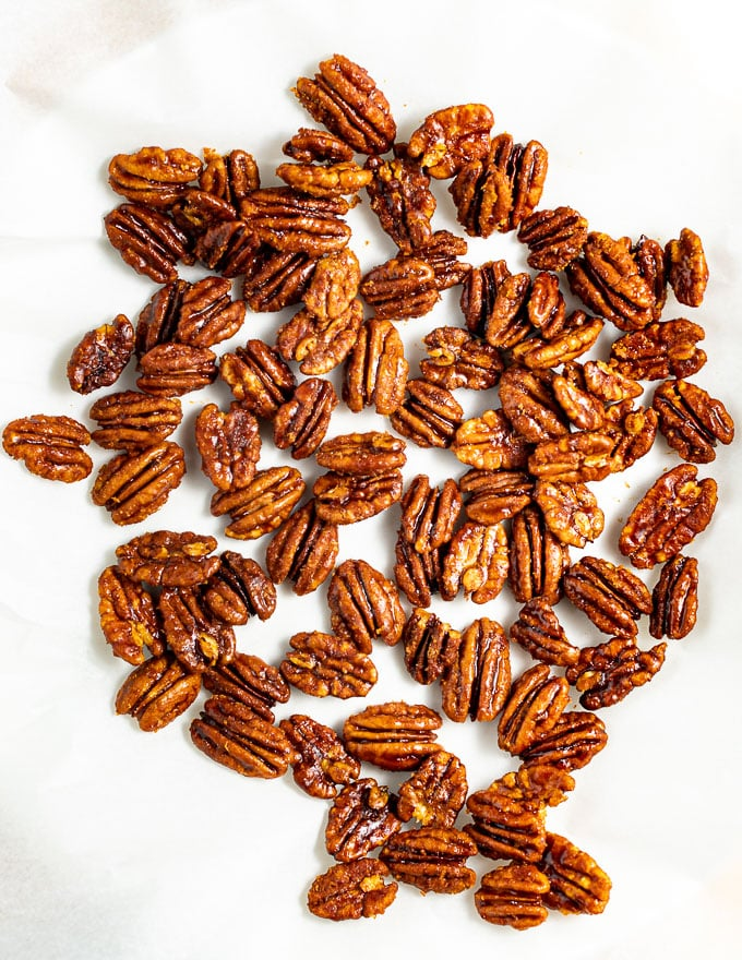 candied pecans on baking parchment