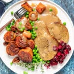 A Vegan Roast with all the trimmings on a white plate
