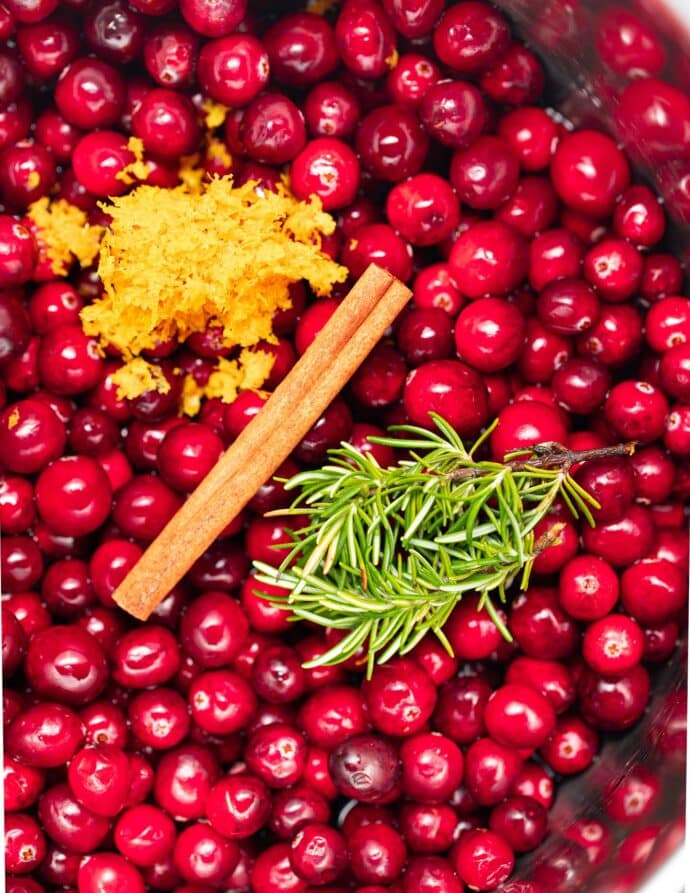 fresh cranberries, rosemary, a cinnamon stick and orange zest in an Instant Pot
