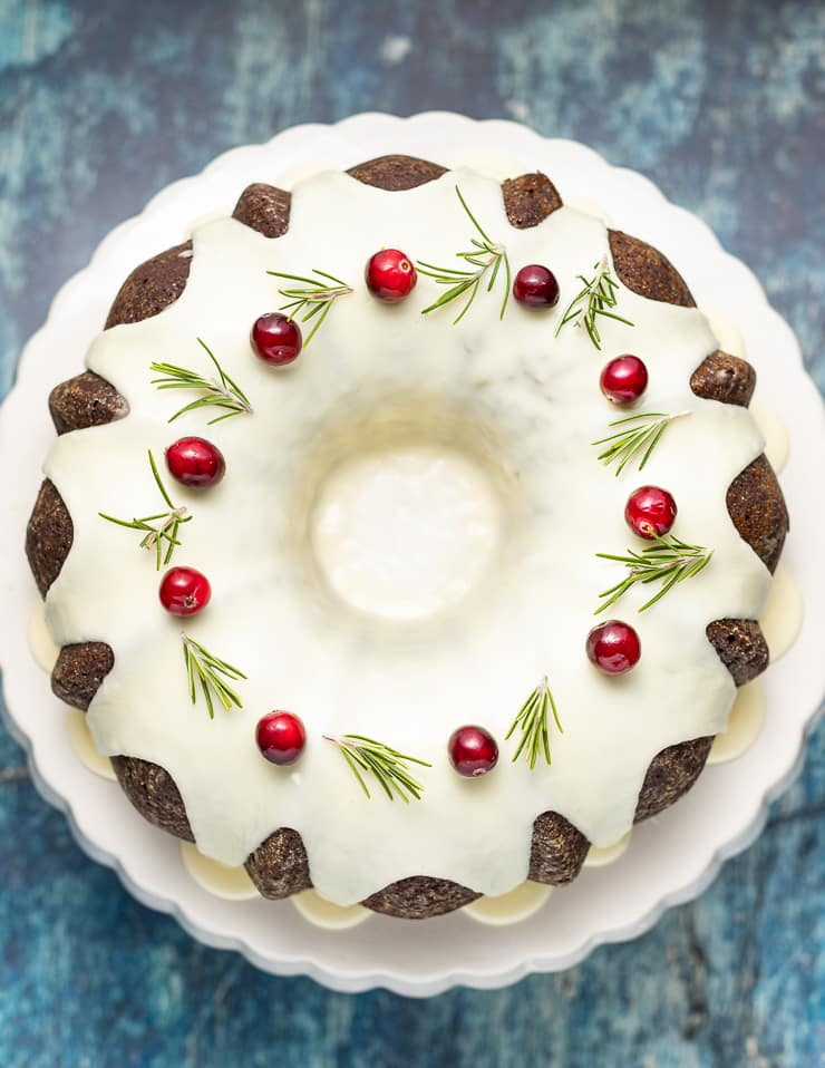 Vegan Gingerbread Cake taken from above to see garnish of fresh cranberries and rosemary