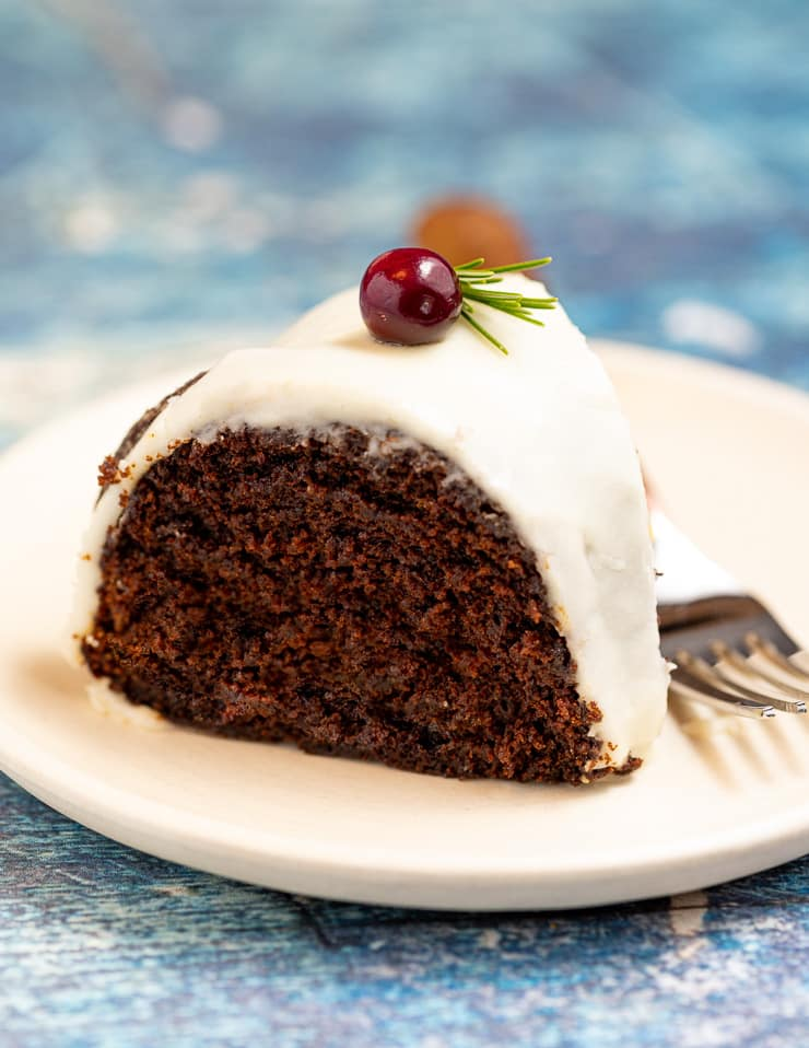 A slice of vegan gingerbread cake on a plate