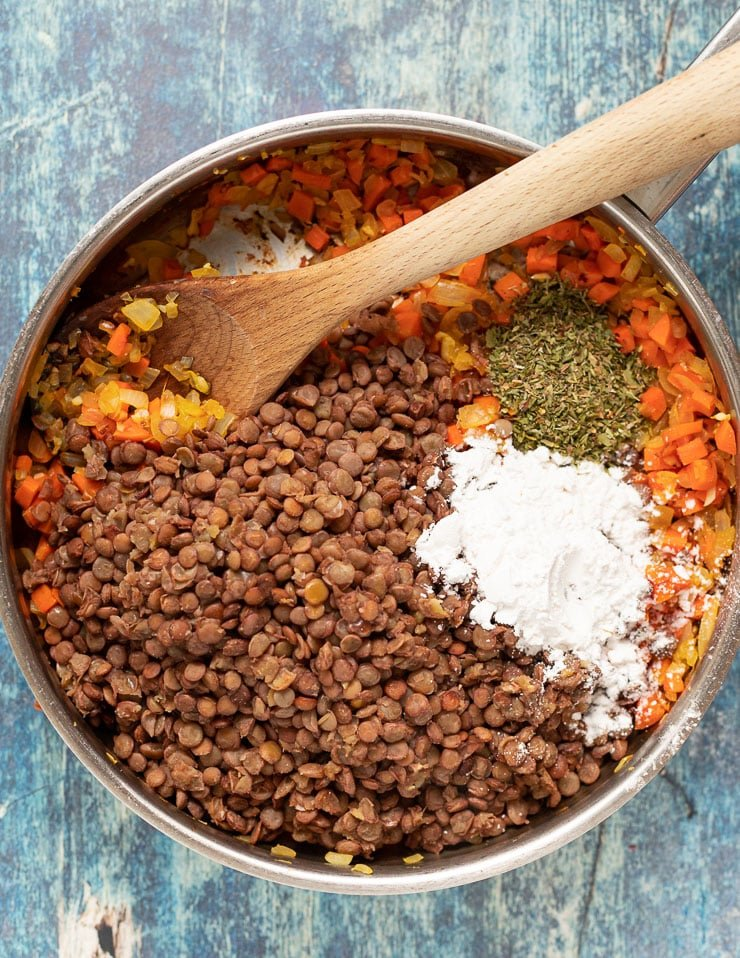 lentils, arrowroot, herbs, carrots, onions and garlic in a pan