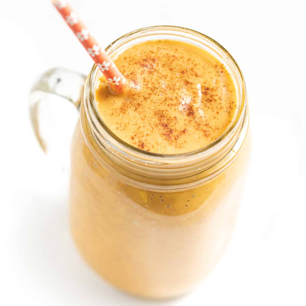 sweet potato smoothie with an orange flowery straw