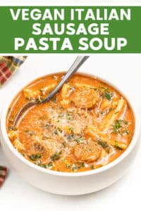 One-pot Vegan Italian Sausage Pasta Soup! It's hearty, rustic and comforting, with a creamy tomato-y soup base, lots of herbs and garlic, vegan sausage chunks and pasta. Ultimate vegan comfort food!