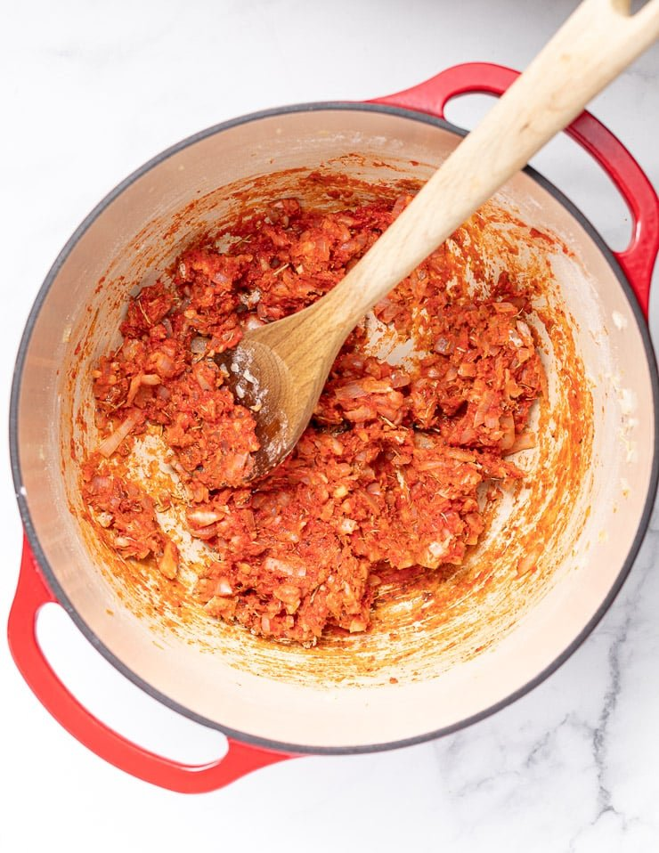 tomato and onion paste mixture in a red Dutch oven