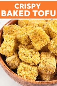 Crispy Tofu with a perfectly seasoned crunchy cornmeal coating. It's oven baked and made with no oil!