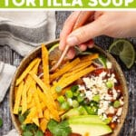 Vegan Tortilla Soup with rich, bold, tomatoey, smoky, limey, garlicky flavor and piles of crispy, crunchy baked tortilla strips. Then come the extra toppings which really seal the deal. It's quick and easy to make and totally delicious!