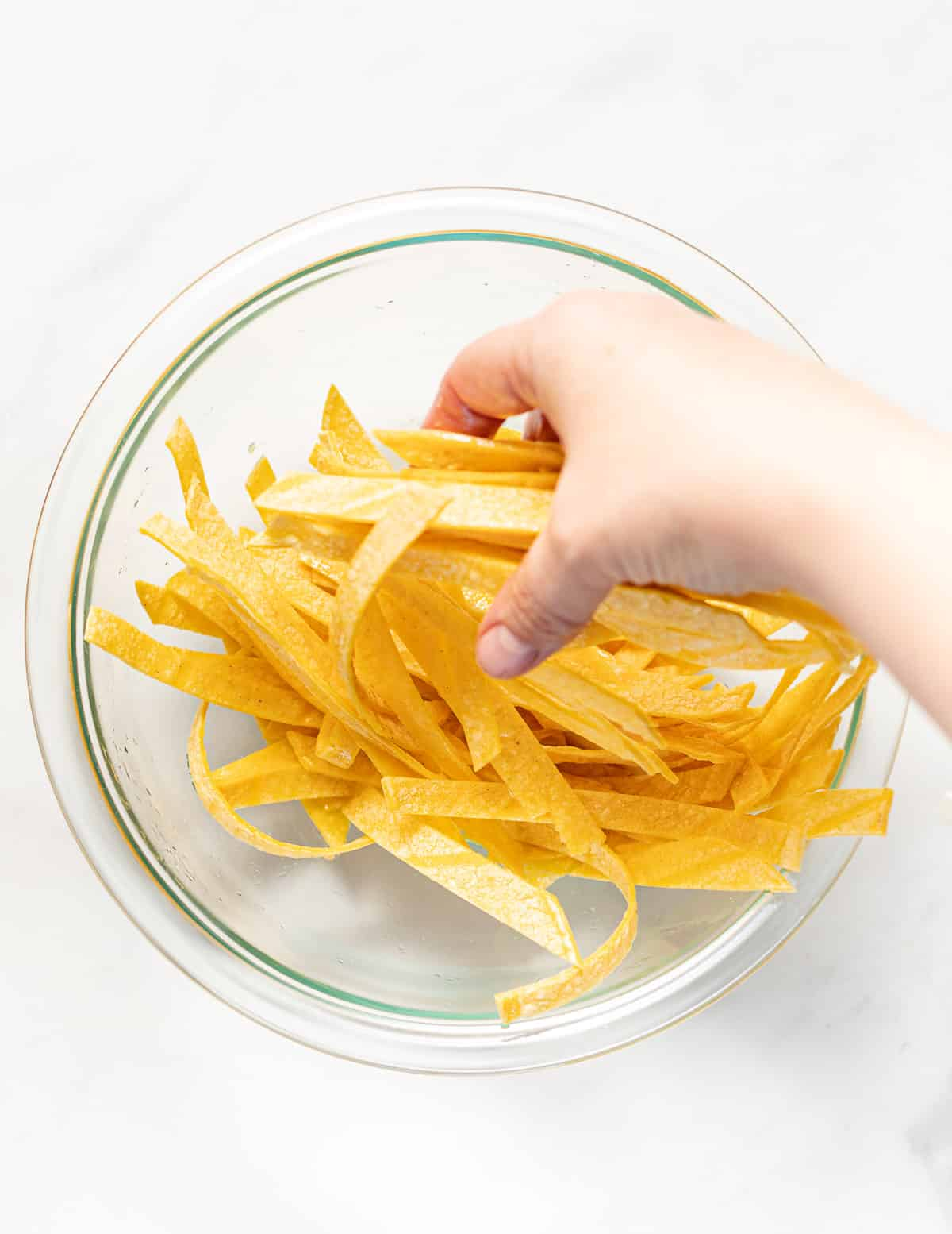 massaging oil into tortilla strips