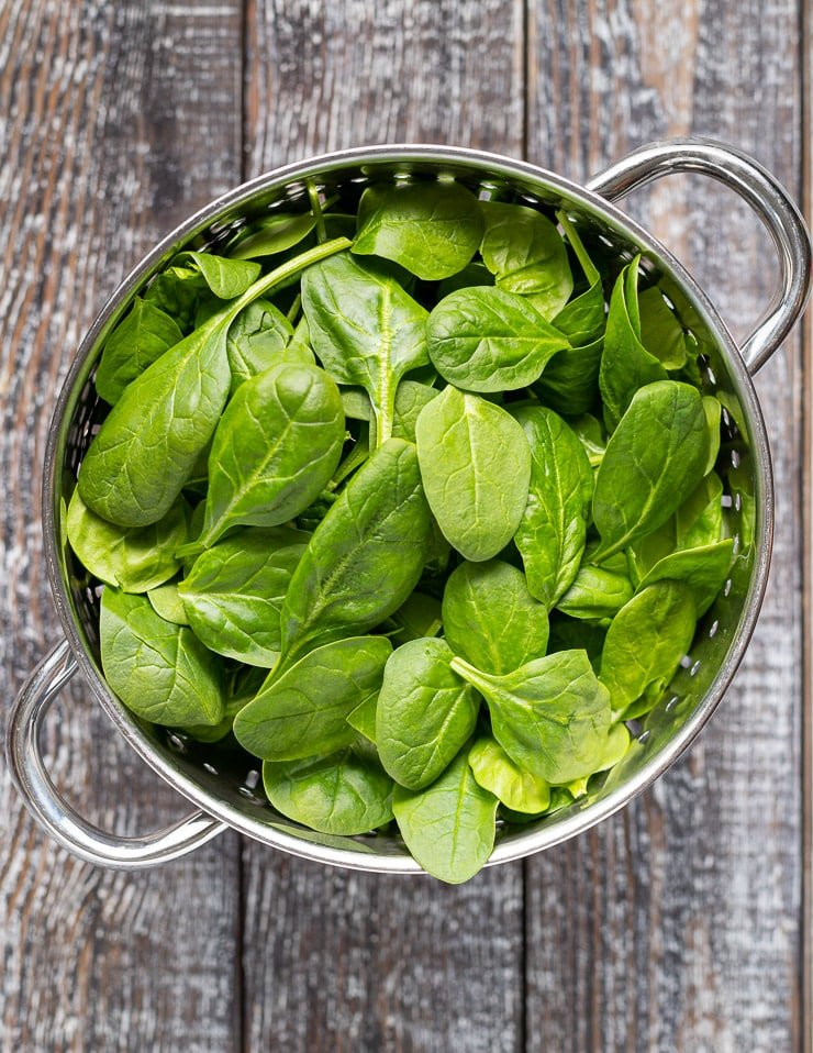 baby spinach in a colander