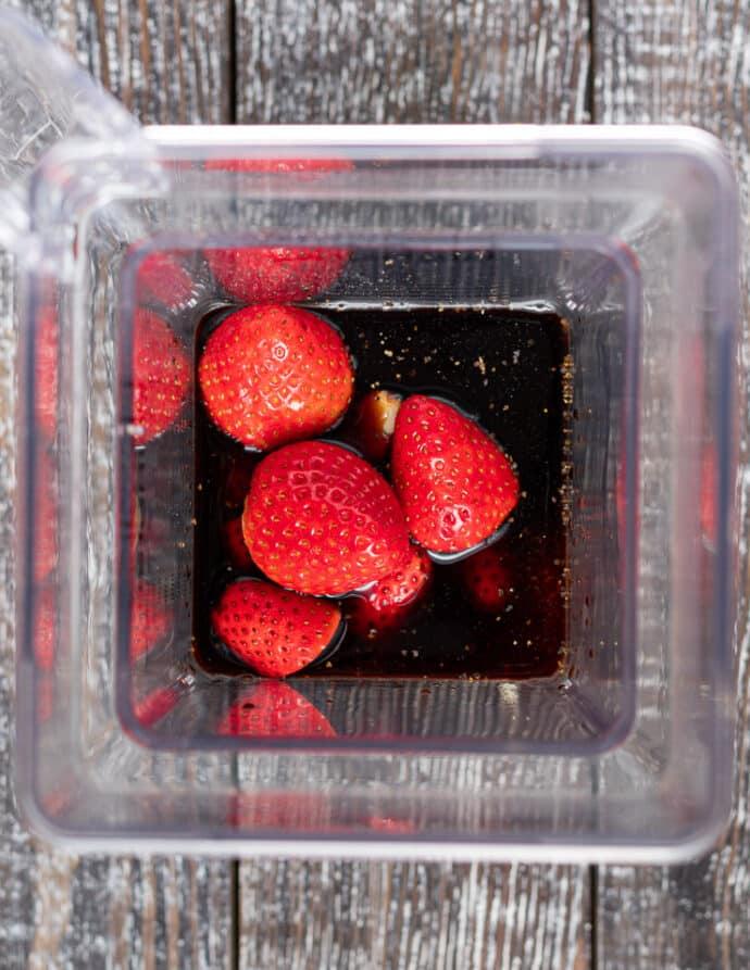 ingredients for oil-free strawberry vinaigrette in a blender