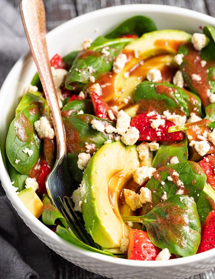 close up of dressed strawberry avocado salad
