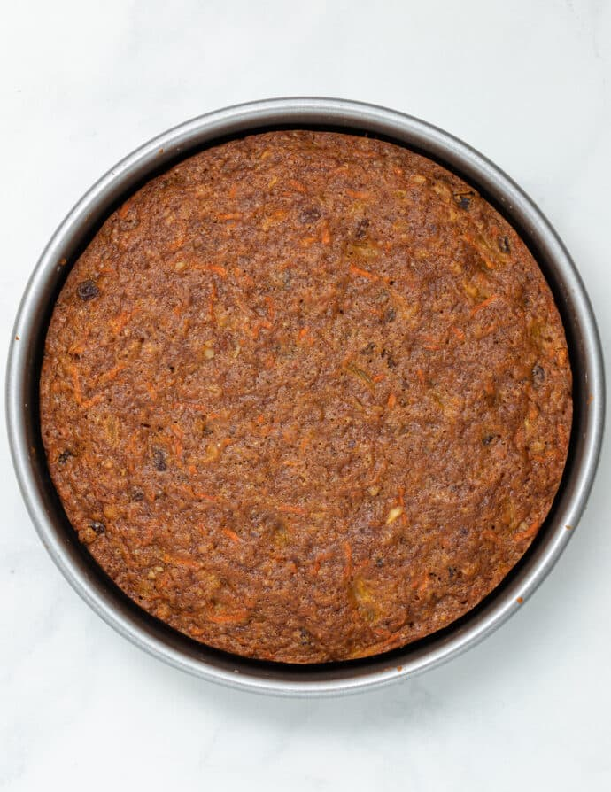 one layer of a vegan carrot cake cooked and in a pan