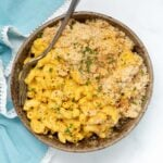 vegan mac and cheese in a bowl with a scattering of fresh parsley