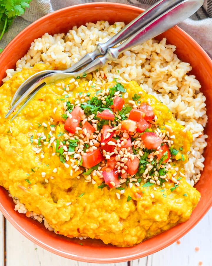 Red Lentil Dahl over rice in a bowl