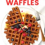 oatmeal waffles topped with fresh berries on a white plate