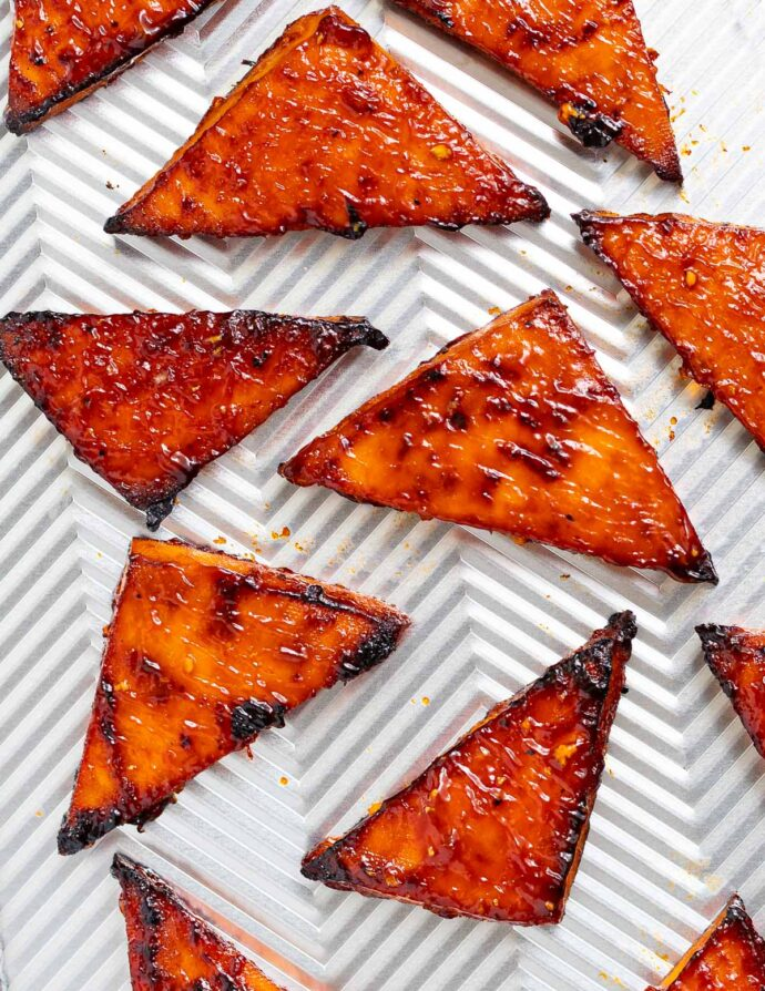 triangles of baked tofu on a baking tray