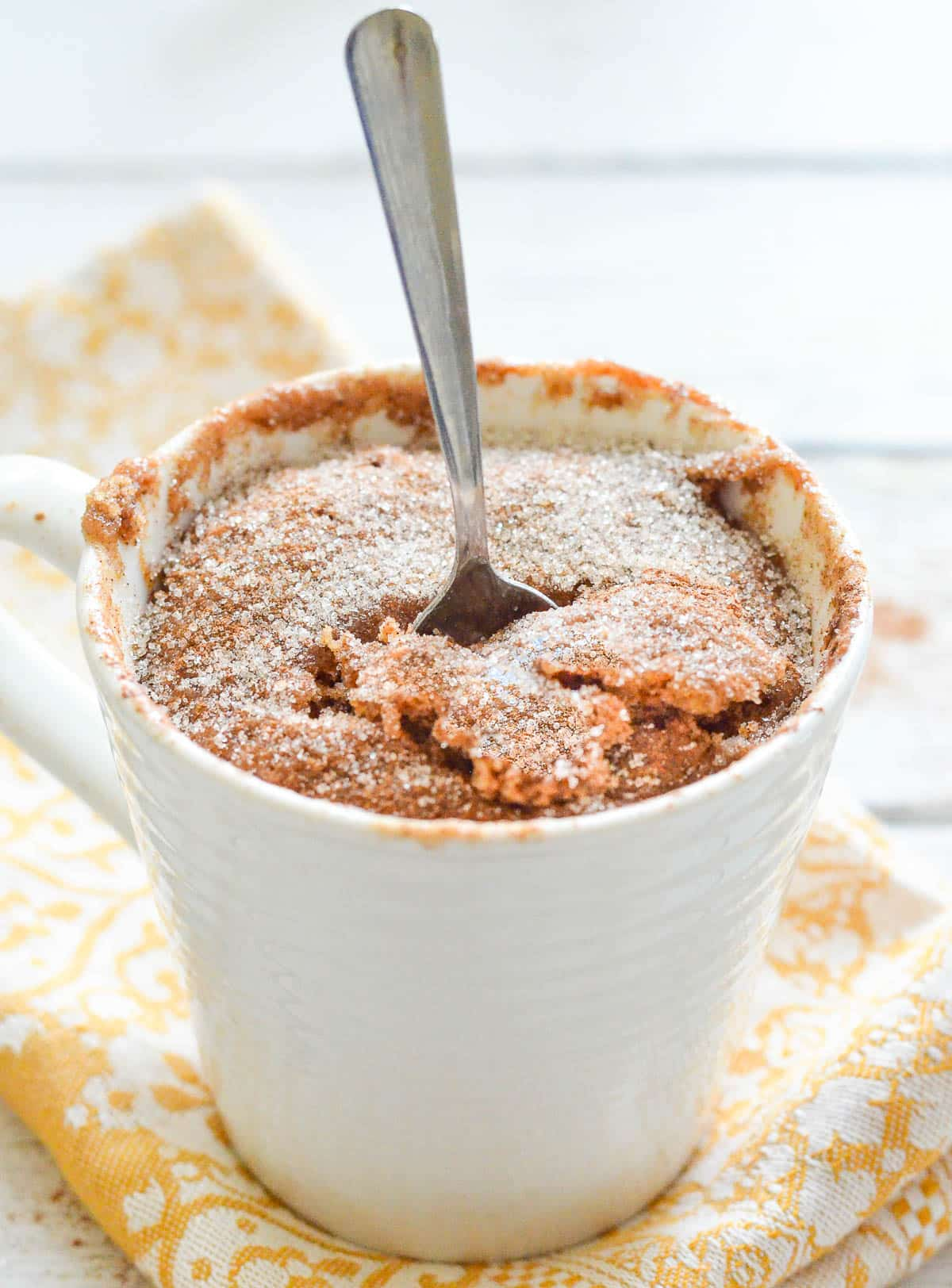 a mug cake with a spoon in it