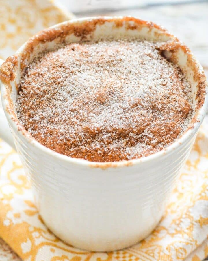 a snickerdoodle mug cake on a yellow napkin