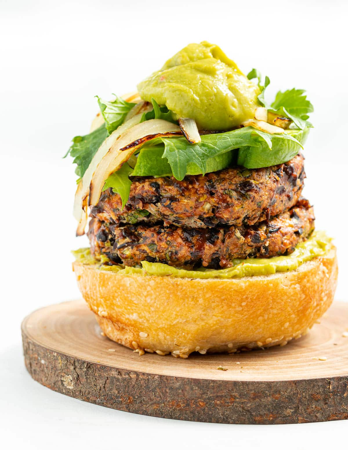 black bean burgers topped with guacamole
