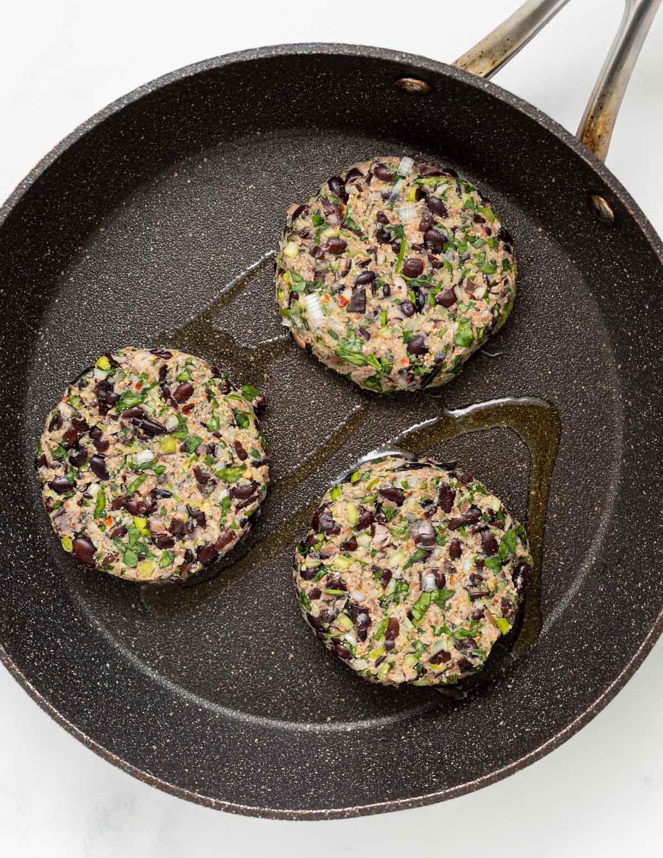 3 veggie burgers in a pan
