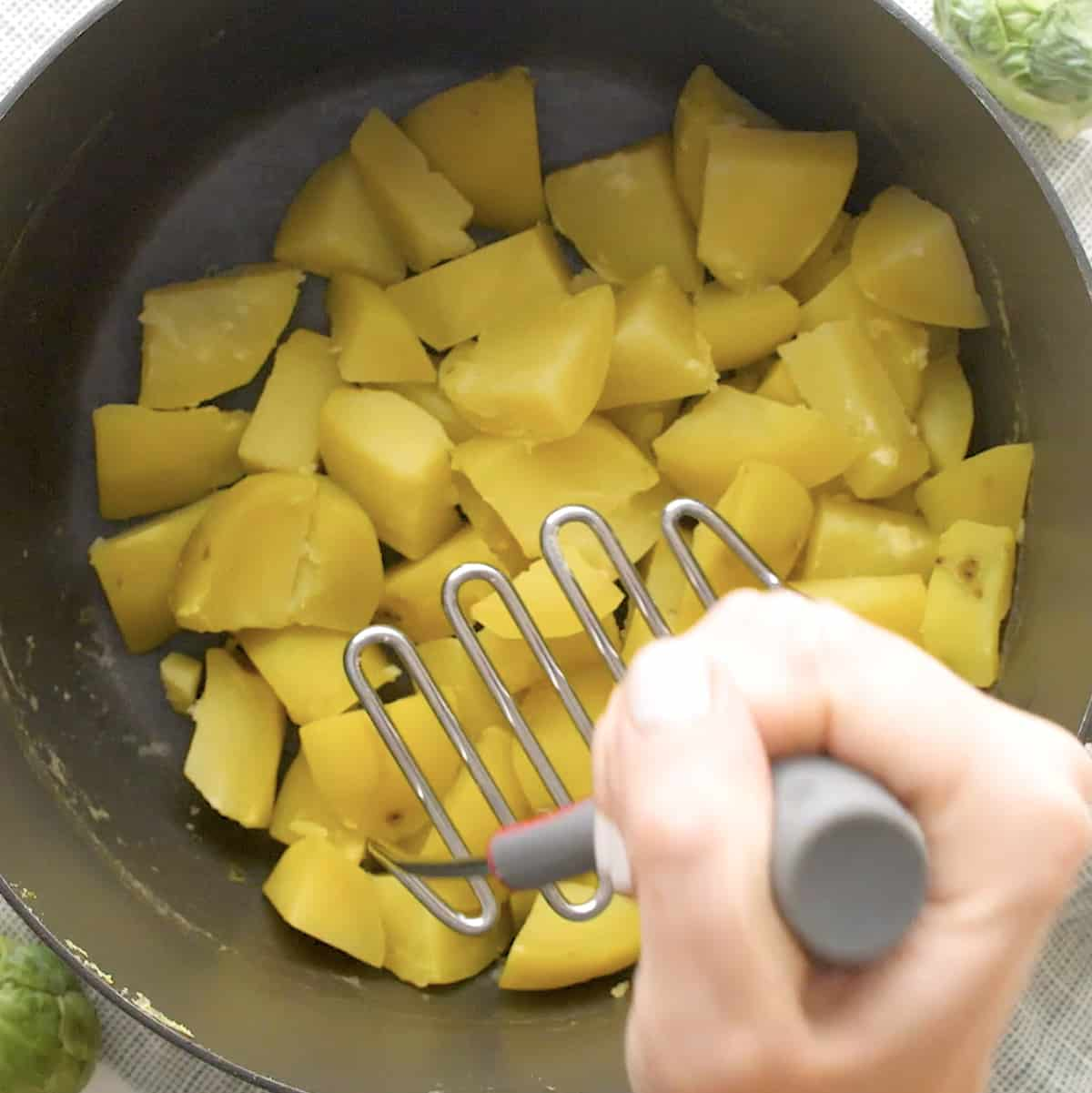 potatoes being mashed
