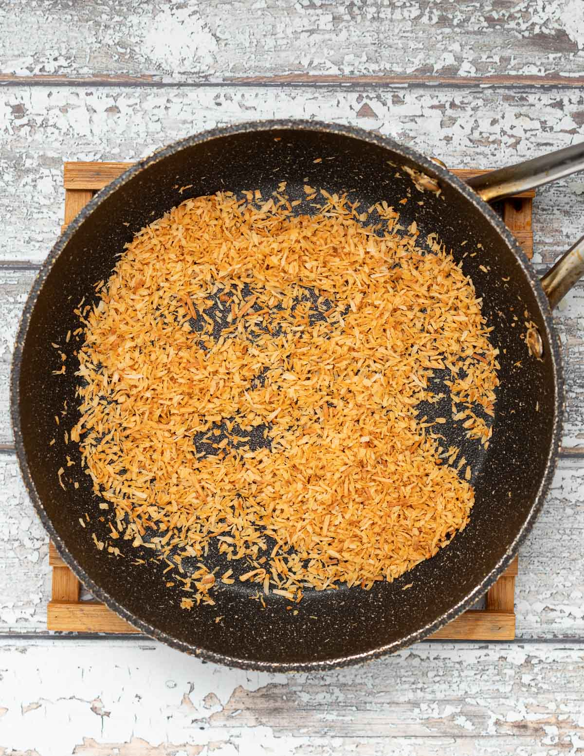 shredded coconut toasting in a pan
