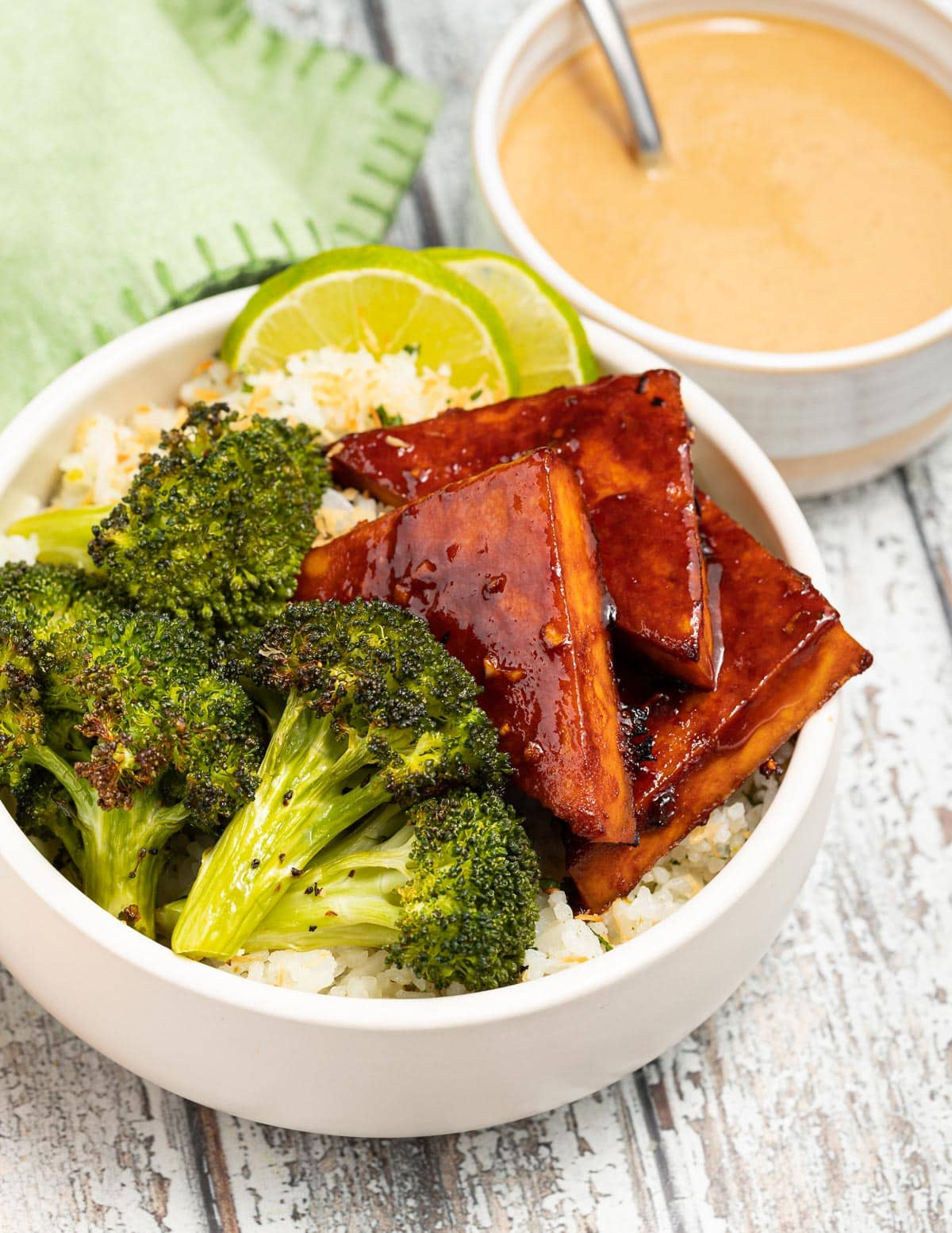 a bowl with rice, broccoli and tofu