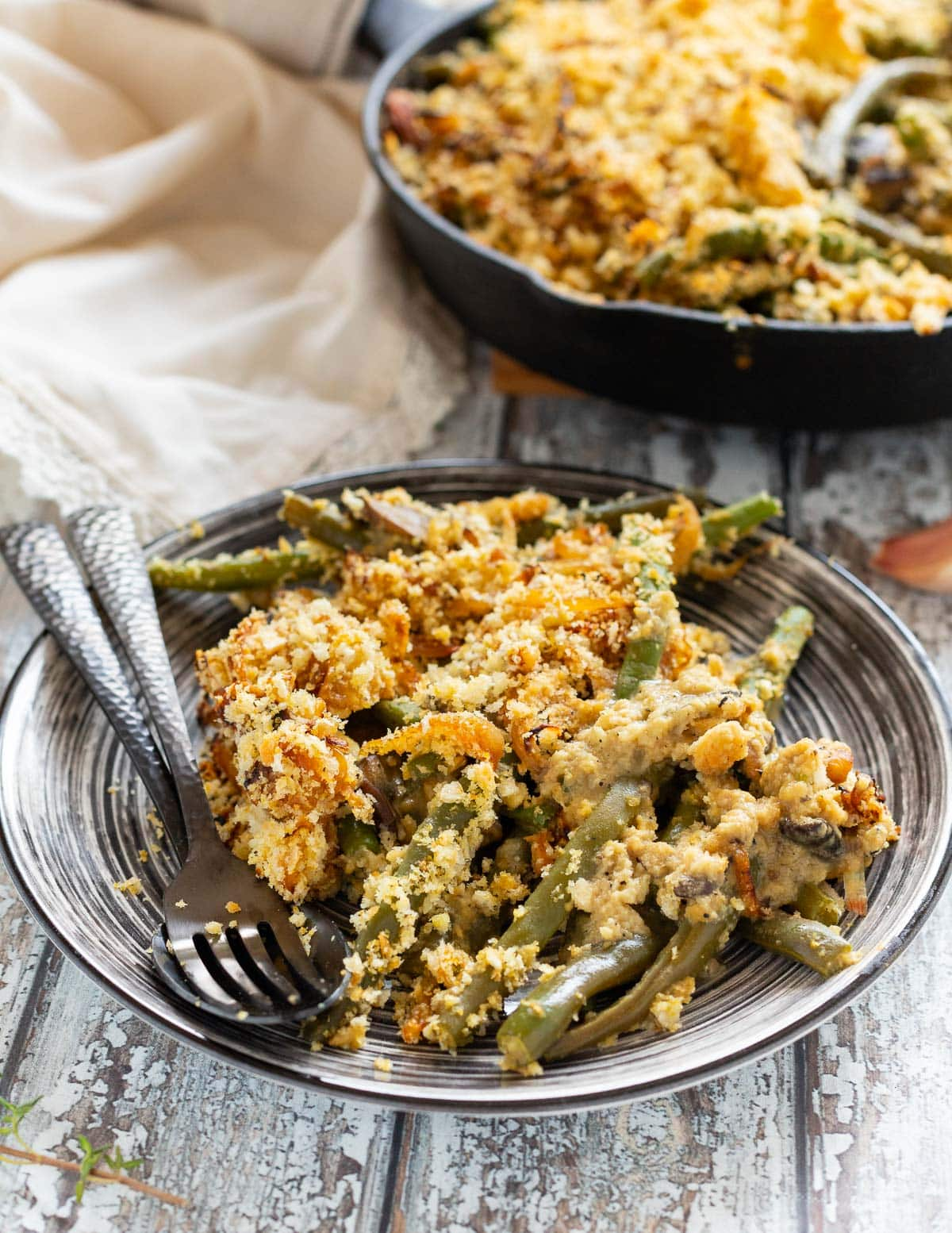 a portion of vegan green bean casserole on a plate